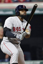 Boston Red Sox's Jackie Bradley Jr. watches his solo home run during the 10th inning of the team's baseball game against the Cleveland Indians, Tuesday, Aug. 13, 2019, in Cleveland. The Red Sox won 7-6. (AP Photo/Tony Dejak)