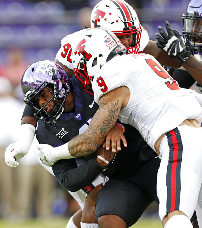 TCU's Shawn Robinson (3) is tackled by Texas Tech's Tony Jones (9) and another player during the first half of an NCAA college football game Thursday, Oct. 11, 2018, in Fort Worth, Texas. (Brad Tollefson/Lubbock Avalanche-Journal via AP)