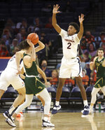 Virginia guard Reece Beekman (2) defends William & Mary guard Thornton Scott (11) during an NCAA college basketball  game Tuesday, Dec. 22, 2020, in Charlottesville, Va. (Andrew Shurtleff/The Daily Progress via AP)