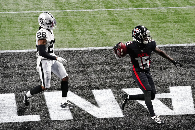 Atlanta Falcons wide receiver Brandon Powell (15) scores a touchdown aginst Las Vegas Raiders cornerback Nevin Lawson (26) during the second half of an NFL football game, Sunday, Nov. 29, 2020, in Atlanta. (AP Photo/Brynn Anderson)