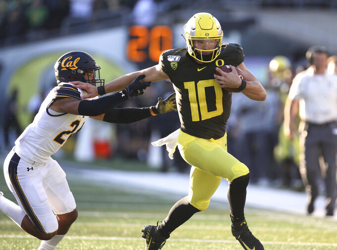 California Oregon quarterback Justin Herbert (10) runs against California's Camryn Bynum during the first quarter of an NCAA college football game Saturday, Oct.. 5, 2019, in Eugene, Ore. (AP Photo/Chris Pietsch)