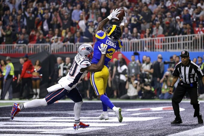 New England Patriots' Jason McCourty (30) breaks up a pass intended for Los Angeles Rams' Brandin Cooks (12) during the second half of the NFL Super Bowl 53 football game Sunday, Feb. 3, 2019, in Atlanta. (AP Photo/Patrick Semansky)