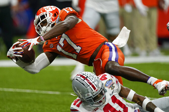 Clemson wide receiver Cornell Powell scores over Ohio State safety Josh Proctor during the second half of the Sugar Bowl NCAA college football game Friday, Jan. 1, 2021, in New Orleans. (AP Photo/John Bazemore)