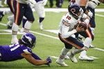 Chicago Bears quarterback Mitchell Trubisky (10) runs from Minnesota Vikings defensive tackle Hercules Mata'afa, left, during the second half of an NFL football game, Sunday, Dec. 20, 2020, in Minneapolis. (AP Photo/Bruce Kluckhohn)