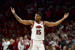 FILE - In this Feb. 4, 2020, file photo, Arkansas guard Mason Jones celebrates after hitting a 3-point shot during the first half of the team's NCAA college basketball game against Auburn in Fayetteville, Ark. Jones was selected to the Associated Press All-SEC first team announced Tuesday, March 10, 2020. Jones also tied for AP SEC Player of the Year. (AP Photo/Michael Woods, File)