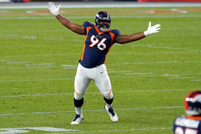 Denver Broncos defensive end Shelby Harris (96) celebrates blocking a field goal attempt by the Tennessee Titans during the first half of an NFL football game, Monday, Sept. 14, 2020, in Denver. (AP Photo/Jack Dempsey)