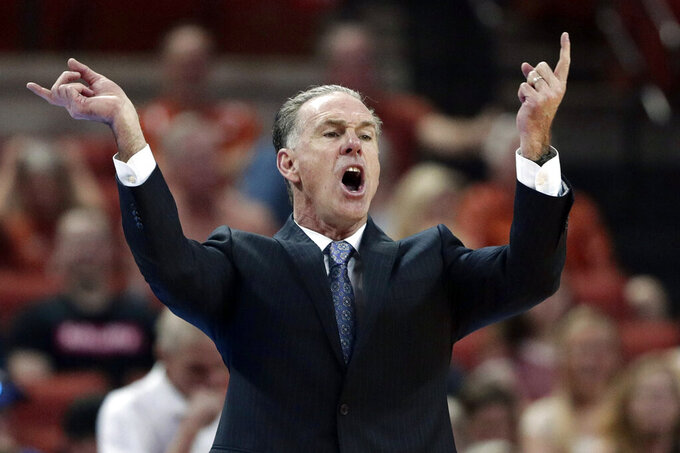 FILE - In this March 9, 2019, file photo, TCU head coach Jamie Dixon directs his players during the first half of an NCAA college basketball game against Texas in Austin, Texas. Dixon is back for his fourth season at his alma mater. The Horned Frogs have been to the postseason each of his three seasons so far.  (AP Photo/Eric Gay, File)