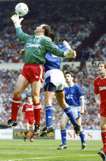 FILE - In this May 20, 1989, file photo, Liverpool's goalkeeper Bruce Grobbelaar stretches to take the ball away from Everton striker Graeme Sharp during the FA Cup Final at Wembley Stadium in London, on May 20, 1989. When Grobbelaar celebrated at Anfield on April 28, 1990, he never thought it would be Liverpool's last league title in three decades.(AP Photo/White, File)
