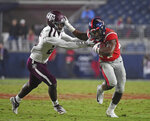 Mississippi running back Snoop Conner (24) stiff-arms Texas A&M defensive back Brian Williams (25) during the second half of an NCAA college football game in Oxford, Miss., Saturday, Oct. 19, 2019. (AP Photo/Thomas Graning)