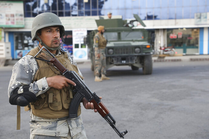 Afghan soldiers stand guard near a polling station in Kabul, Afghanistan, Saturday, Sept. 28, 2019. Afghans headed to the polls on Saturday to elect a new president amid high security and Taliban threats to disrupt the elections, with the rebels warning citizens to stay home or risk being hurt. (AP Photo/Ebrahim Nooroozi)
