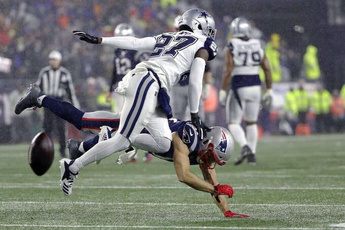 New England Patriots wide receiver Julian Edelman, below, can't catch a pass as Dallas Cowboys cornerback Jourdan Lewis defends in the first half of an NFL football game, Sunday, Nov. 24, 2019, in Foxborough, Mass. (AP Photo/Steven Senne)