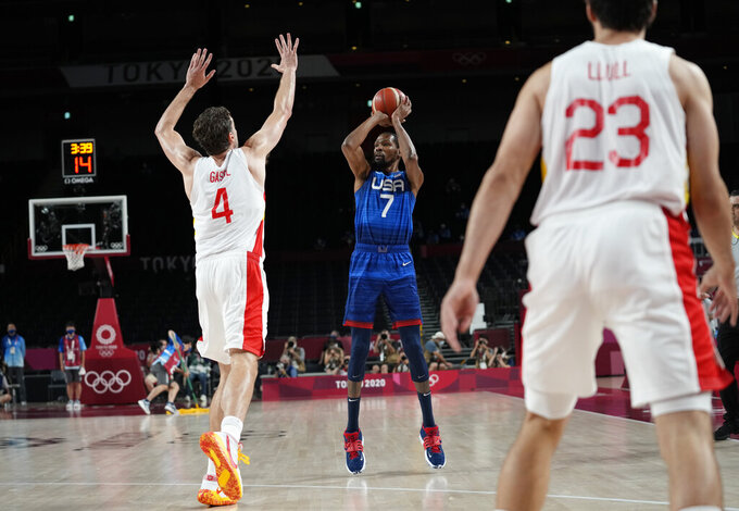 United States' Kevin Durant (7), center, shoots over Spain's Pau Gasol (4) during men's basketball quarterfinal game at the 2020 Summer Olympics, Tuesday, Aug. 3, 2021, in Saitama, Japan. (AP Photo/Eric Gay)