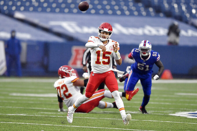 Kansas City Chiefs quarterback Patrick Mahomes throws a pass during the first half of an NFL football game against the Buffalo Bills, Monday, Oct. 19, 2020, in Orchard Park, N.Y. (AP Photo/Adrian Kraus)