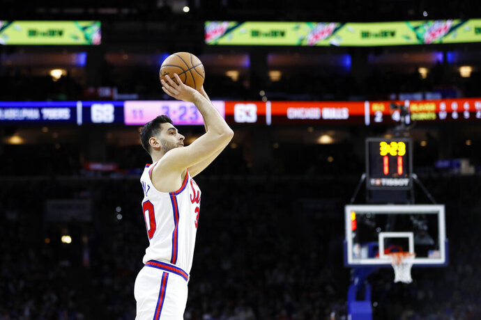Philadelphia 76ers' Furkan Korkmaz goes up to shoot during the second half of an NBA basketball game against the Chicago Bulls, Friday, Jan. 17, 2020, in Philadelphia. (AP Photo/Matt Slocum)