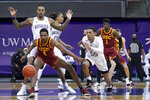 Southern California forward Evan Mobley (4) and Washington guard Quade Green (55) eye a loose ball during the first half of an NCAA college basketball game Thursday, Feb. 11, 2021, in Seattle. (AP Photo/Ted S. Warren)