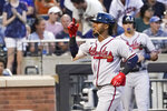 Atlanta Braves' Ozzie Albies celebrates after hitting a two-run home run during the second inning of a baseball game against the New York Mets, Tuesday, July 27, 2021, in New York. (AP Photo/Mary Altaffer)