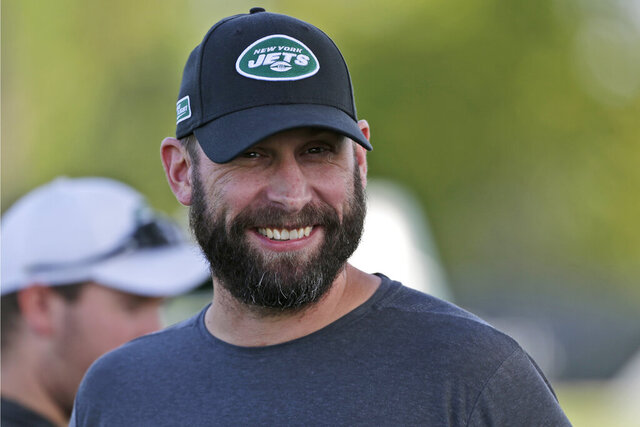 FILE - In this Thursday, July 25, 2019, file photo, New York Jets head coach Adam Gase smiles during practice at the NFL football team's training camp in Florham Park, N.J.  Adam Gase still absolutely envisions Jamal Adams as a member of the New York Jets this season. (AP Photo/Seth Wenig, File)