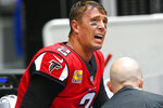 Atlanta Falcons quarterback Matt Ryan reacts as medical personel attend to him after injury against the Los Angeles Rams during the second half of an NFL football game, Sunday, Oct. 20, 2019, in Atlanta. (AP Photo/John Amis)