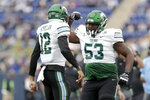 Tulane quarterback Justin McMillan (12) and offensive lineman Keyshawn McLeod (53) celebrate McMillan's touchdown against Navy during the first half of an NCAA college football game, Saturday, Oct. 26, 2019, in Annapolis. (AP Photo/Julio Cortez)