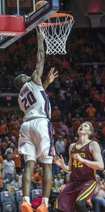 Illinois guard Da'Monte Williams (20) gets a tap-in basket over Minnesota forward Michael Hurt (42) during the first half of an NCAA college basketball game in Champaign, Ill., Wednesday, Jan. 16, 2019. (AP Photo/Rick Danzl)