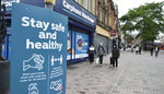 People walk in Leicester city centre, England, Tuesday June 30, 2020. The British government has reimposed lockdown restrictions in the English city of Leicester after a spike in coronavirus infections, including the closure of shops that don't sell essential goods and schools. (AP Photo/Rui Vieira)