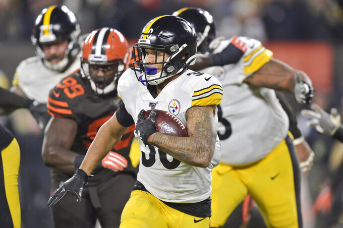 Pittsburgh Steelers running back James Conner (30) rushes against the Cleveland Browns during the first half of an NFL football game Thursday, Nov. 14, 2019, in Cleveland. (AP Photo/David Richard)