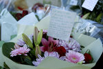 A tributes message with flowers, placed by the southern end of London Bridge in London, Monday, Dec. 2, 2019. London Bridge reopened to cars and pedestrians Monday, three days after a man previously convicted of terrorism offenses stabbed two people to death and injured three others before being shot dead by police. (AP Photo/Matt Dunham)
