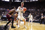 Purdue center Matt Haarms (32) drives on Minnesota center Daniel Oturu (25) during the second half of an NCAA college basketball game in West Lafayette, Ind., Thursday, Jan. 2, 2020. Purdue defeated Minnesota 83-78 in double overtime. (AP Photo/Michael Conroy)