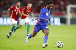 England's Raheem Sterling runs with the ball during the World Cup 2022 group I qualifying soccer match between Hungary and England at the Ferenc Puskas stadium in Budapest, Hungary, Thursday, Sept. 2, 2021. (AP Photo/Laszlo Balogh)
