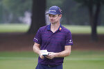 Justin Rose, of England, holds his scorecard on the 10th green after making a bogey during the first round of the Wyndham Championship golf tournament at Sedgefield Country Club on Thursday, Aug. 13, 2020, in Greensboro, N.C. (AP Photo/Chris Carlson)