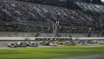 Riley Herbst (51) and Christian Eckes (18) lead the field to start the NASCAR Truck Series auto race at Daytona International Speedway, Friday, Feb. 14, 2020, in Daytona Beach, Fla. (AP Photo/Terry Renna)