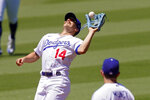 Los Angeles Dodgers shortstop Kiké Hernández makes a catch on a ball hit by San Francisco Giants' Mike Yastrzemski during the third inning of a baseball game Sunday, Aug. 9, 2020, in Los Angeles. (AP Photo/Mark J. Terrill)