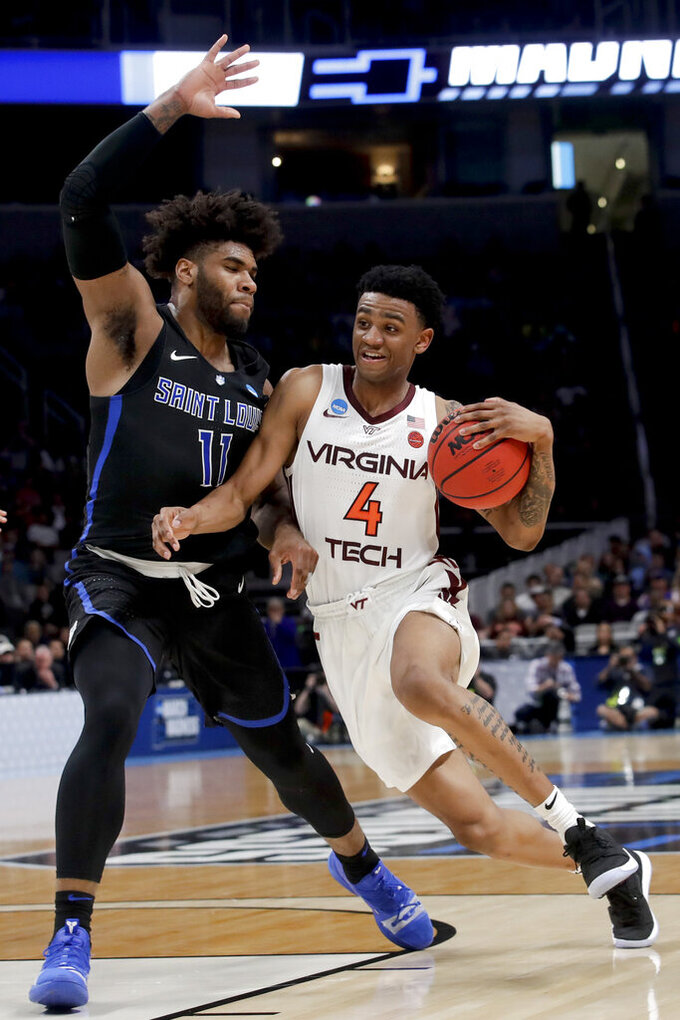 Virginia Tech guard Nickeil Alexander-Walker, drives to the basket past Saint Louis forward Hasahn French during the first half of a first-round game in the NCAA men's college basketball tournament Friday, March 22, 2019, in San Jose, Calif. (AP Photo/Jeff Chiu)
