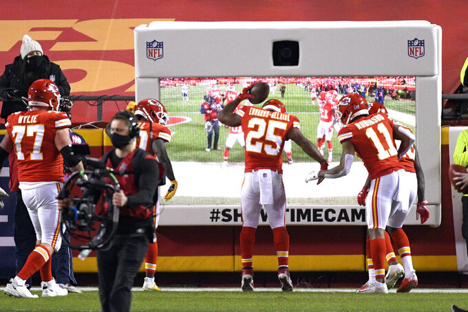 Kansas City Chiefs running back Clyde Edwards-Helaire (25) celebrates with teammates after scoring on a 1-yard touchdown run during the first half of the AFC championship NFL football game against the Buffalo Bills, Sunday, Jan. 24, 2021, in Kansas City, Mo. (AP Photo/Reed Hoffmann)