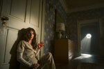 """This image released by Warner Bros. Entertainment shows Annabelle Wallis in a scene from """"Malignant."""" (Warner Bros. via AP)"""