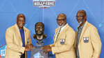 From left to right, Lynn Swann, Donnie Shell and John Stallworth pose during the induction ceremony at the Pro Football Hall of Fame, Saturday, Aug. 7, 2021, in Canton, Ohio. (AP Photo/Ron Schwane, Pool)