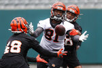 Cincinnati Bengals linebacker Deshaun Davis (48) intercepts a pass against wide receiver Ventell Bryant (81) during practice at the team's NFL football facility, Wednesday, June 12, 2019, in Cincinnati. (AP Photo/John Minchillo)