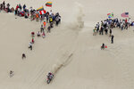 Martin Duplessis of Argentina rides his Honda motorbike during the first stage of the Dakar Rally between Lima and Pisco, Peru, Monday, Jan. 7, 2019. (AP Photo/Ricardo Mazalan)
