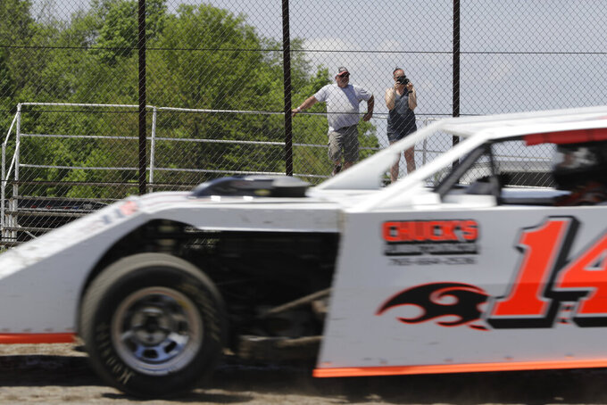 Fans watch as cars practice at Gas City I-69 Speedway, Sunday, May 24, 2020, in Gas City, Ind. (AP Photo/Darron Cummings)