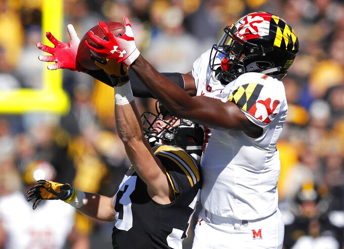 FILE - In this Oct. 20, 2018, file photo, Iowa defensive back Riley Moss, left, breaks up a pass intended for Maryland wide receiver Dontay Demus during the first half of an NCAA college football game, in Iowa City, Iowa. Interim coach Matt Canada came up with all sorts of reasons why Maryland's offense went nowhere last weekend in a shutout loss to Iowa. (AP Photo/Charlie Neibergall, File)