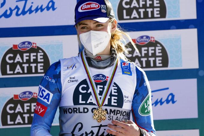 United States' Mikaela Shiffrin shows her bronze medal on the podium of the women's slalom, at the alpine ski World Championships in Cortina d'Ampezzo, Italy, Saturday, Feb. 20, 2021. (AP Photo/Giovanni Auletta)