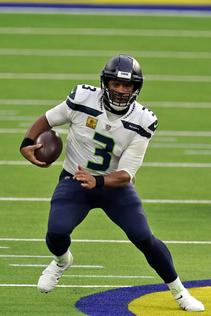 Seattle Seahawks quarterback Russell Wilson (3) runs against the Los Angeles Rams during the first half of an NFL football game Sunday, Nov. 15, 2020, in Inglewood, Calif. (AP Photo/Jae C. Hong)