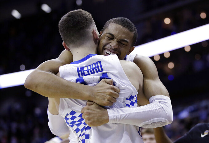 CORRECTS TO KELDON JOHNSON, INSTEAD OF PJ WASHINGTON - Kentucky's Keldon Johnson, rear, celebrates with teammate Tyler Herro near the end of a men's NCAA tournament college basketball Midwest Regional semifinal against Houston, Friday, March 29, 2019, in Kansas City, Mo. (AP Photo/Charlie Riedel)