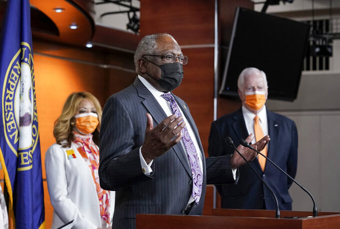 House Majority Whip James Clyburn, D-S.C., flanked by Rep. Lucy McBath, D-Ga., left, and Rep. Mike Thompson, D-Calif., chairman of the House Gun Violence Prevention Task Force, speaks a news conference on passage of gun violence prevention legislation, at the Capitol in Washington, Thursday, March 11, 2021. (AP Photo/J. Scott Applewhite)
