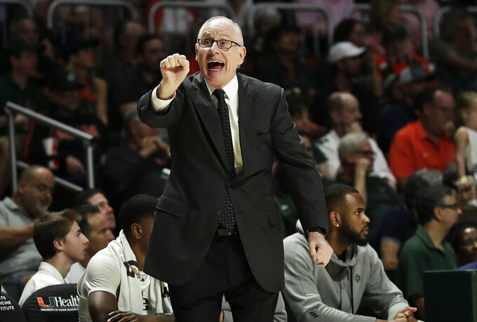 Miami head coach Jim Larranaga gestures to his players during the first half of an NCAA college basketball game against North Carolina on Saturday, Jan. 19, 2019, in Coral Gables, Fla. (AP Photo/Brynn Anderson)