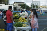 In this May 2, 2020 photo, local farmers, wearing protective as a measure to curb the spread of the new coronavirus, sell their products to residents, in San Cristobal, Galapagos Islands, Ecuador. For many islanders, the pandemic has left them to meditate on their relationships with nature, industry and travel. Some wonder if they should continue to remain so dependent on tourism, while others say it highlights the need for self-sufficiency. (AP Photo/Adrian Vasquez)