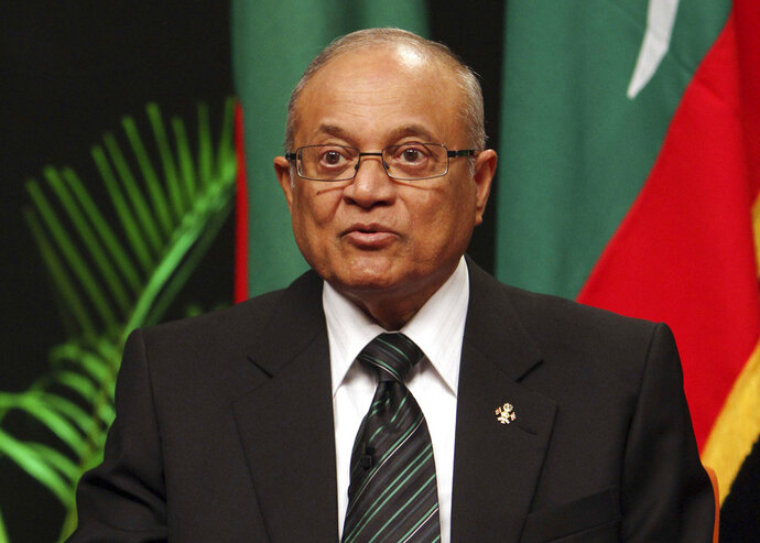 FILE - In this Sept. 5, 2011 file photo, Maldives' former President Maumoon Abdul Gayoom addresses a press conference to announce the formation of a new political party in Male, Maldives. A Maldives court sentenced Gayoom to one year, seven months and six days in prison on Wednesday, June 13, 2018, for failing to hand over his mobile phone to investigators. India says it is dismayed by the 19-month prison sentence given to a former leader of the Maldives for failing to cooperate with a police investigation. (AP Photo/Sinan Hussain, File)