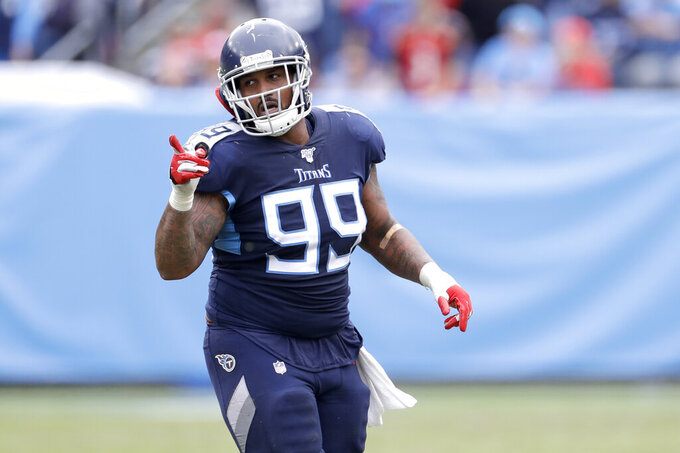 FILE — In this Oct. 27, 2019, file photo, Tennessee Titans defensive end Jurrell Casey plays against the Tampa Bay Buccaneers in an NFL football game in Nashville, Tenn. The four-time Pro Bowl defensive lineman turned in one of the Titans' best playoff performances to put them into the AFC championship game against the Kansas City Chiefs. (AP Photo/James Kenney, File)
