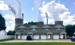FILE - In this Aug. 23, 2018, file photo, a coal-fired plant in Winfield, W.Va, is seen from an apartment complex in the town of Poca across the Kanawha River. The Trump administration is gutting an Obama-era rule that compelled coal plants to cut back emissions of mercury and other human health hazards, limiting future regulation of air pollutants by petroleum and coal plants. (AP Photo/John Raby, File)