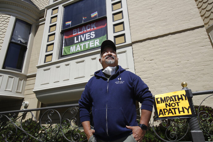 FILE - In this June 14, 2020, file photo, James Juanillo poses outside of his home in San Francisco. Fed up with white people calling 911 about people of color selling water bottles, barbecuing or otherwise going about with life, San Francisco Board of Supervisors will vote Tuesday, Oct. 20, 2020, on the Caution Against Racial and Exploitative Non-Emergencies Act, also known as the CAREN legislation, a nod to a widespread meme using the name